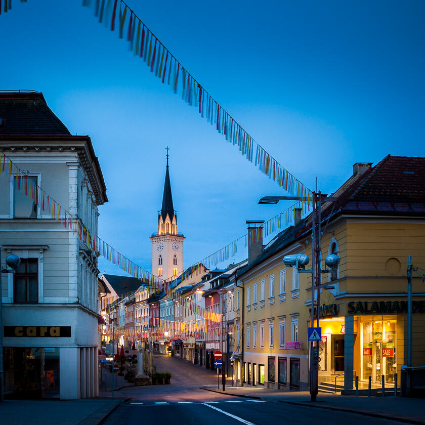 The view up Hauptplatz in Villach, with St. Jakob's Church in the background.