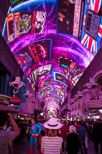 The dazzling lightshow at the Fremont Street Experience and a girl in a white hat. Also a man dressed as Superman.
