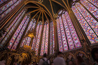 The interior of Sainte Chapelle, showing the stained glass windows and vaulted ceiling.