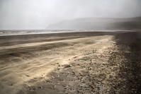 A streak of white sand on a mostly black volcanic sand beach in Glen Brittle, Isle of Skye.