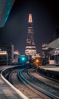 A view of the Shard from London Waterloo East Railway Station at night.