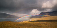 A double rainbow arches between Loch Brittle and Sgùrr nan Gobhar on the Isle of Skye.